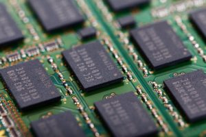 A close-up of a circuit board showing semiconductors or computer chips