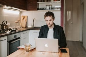 man working from home in kitchen